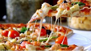 КупонМания предлагает откушать! От 4 до 9 пицц на выбор от службы доставки Jeremy's Bar! Скидка до 57%!